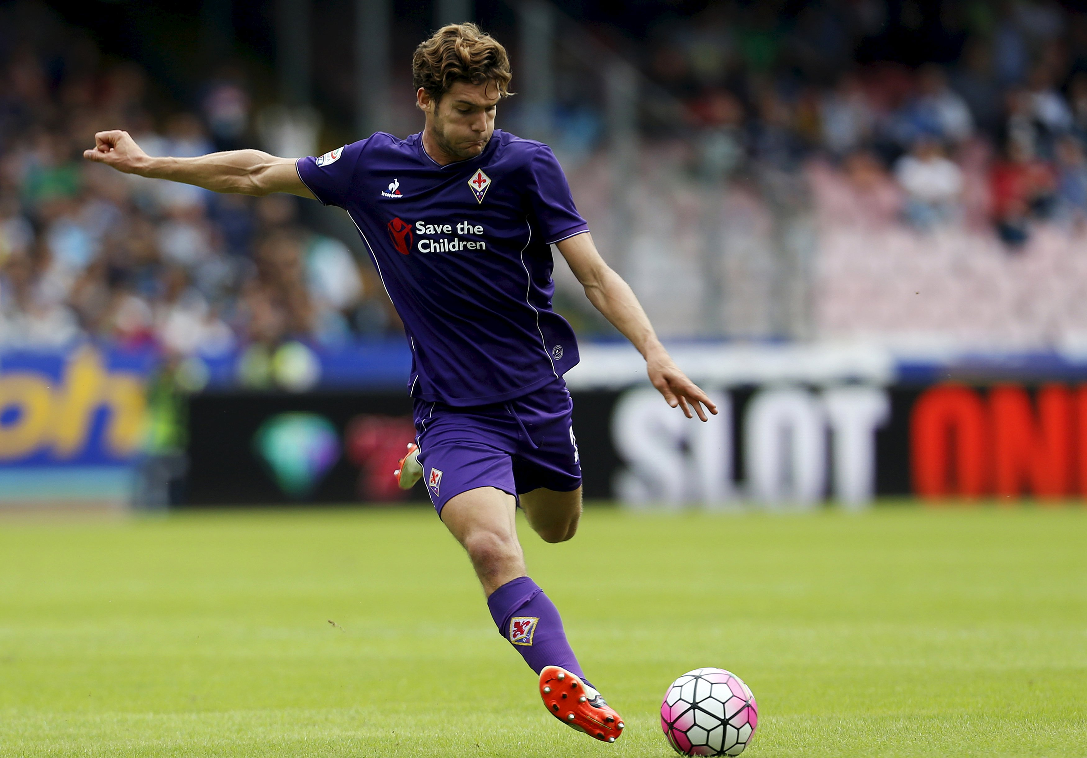 Fiorentina's Alonso shoots a ball during their Italian Serie A soccer match against Napoli in Naples