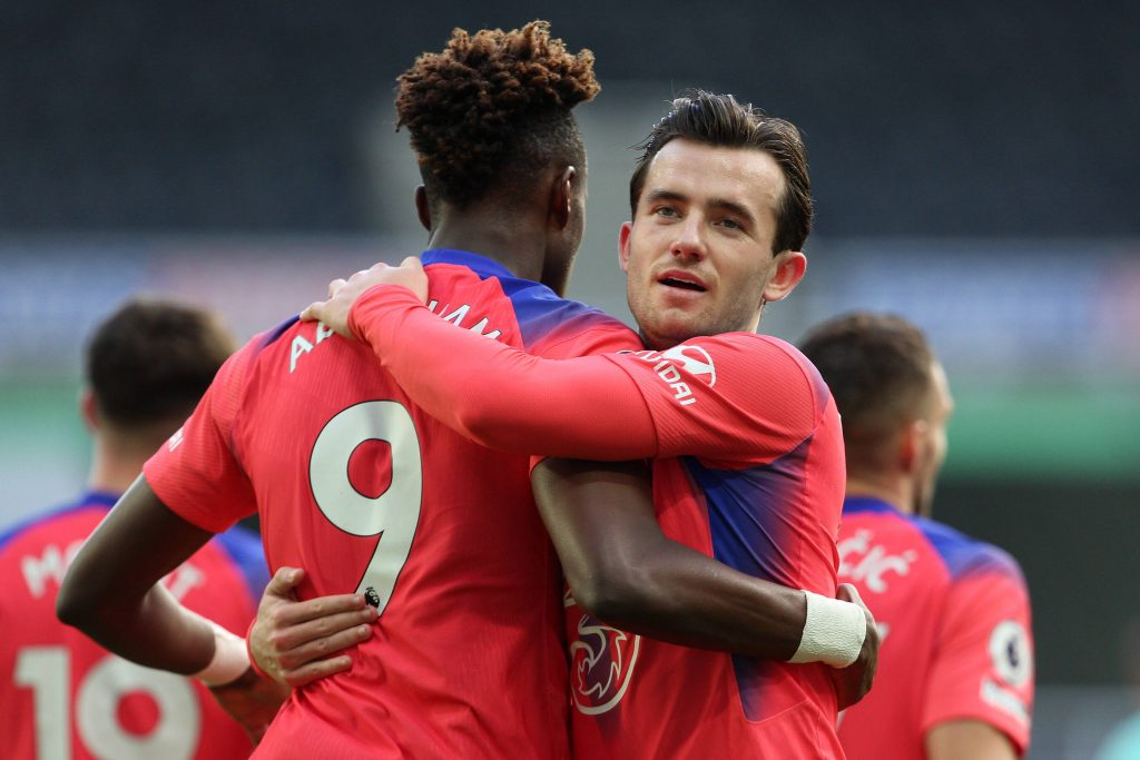 Tammy Abraham and Ben Chilwell celebrate a Chelsea goal together.