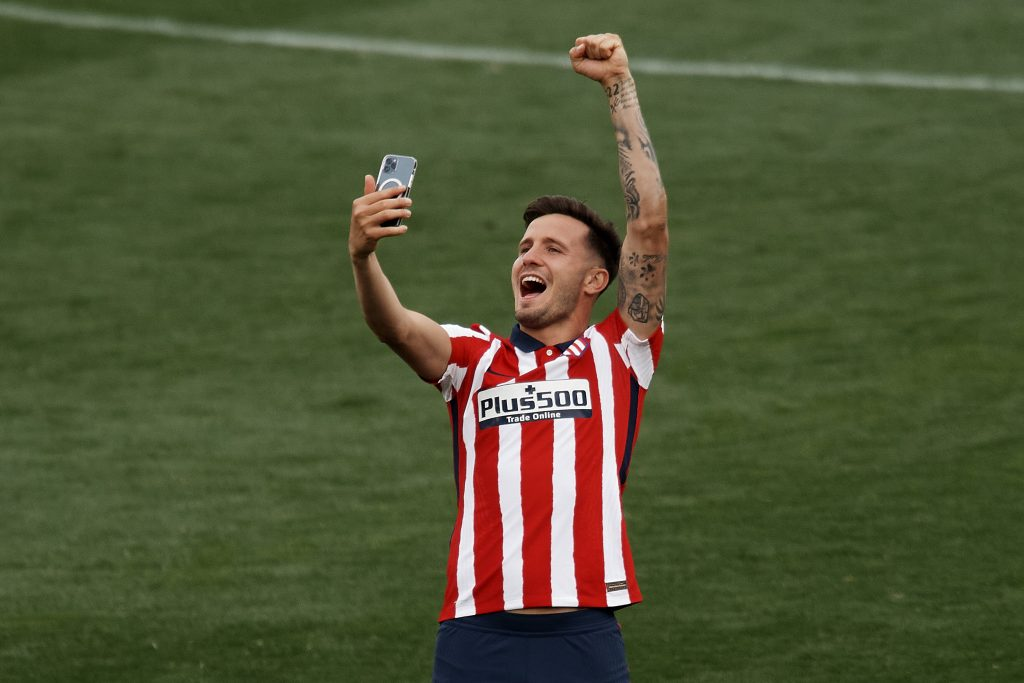 Saul Niguez of Atletico Madrid celebrates after winning the league championship