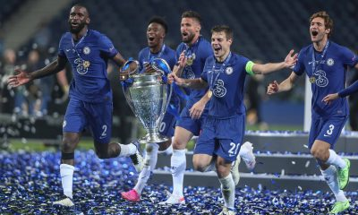 Chelsea players with the UEFA Champions League trophy.